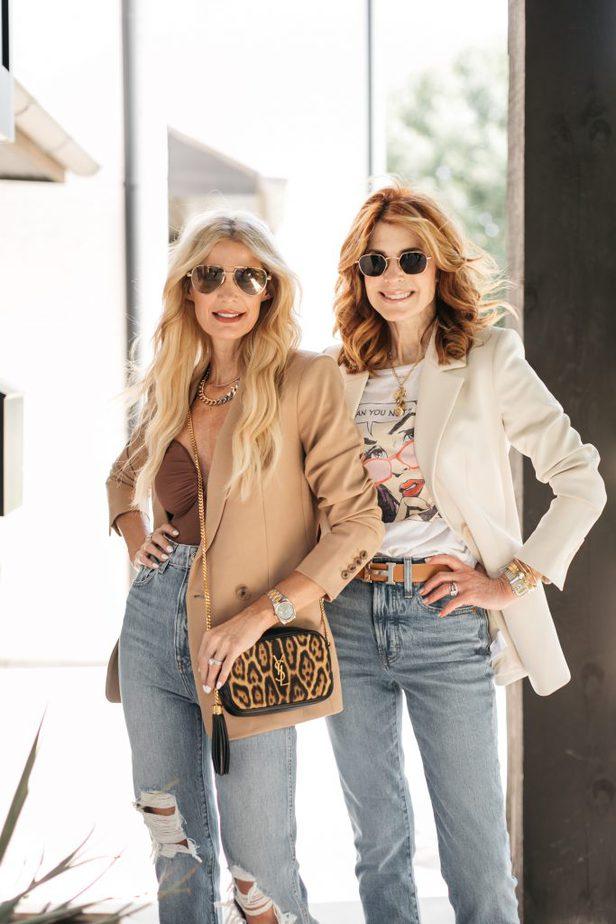 two women wearing blazers