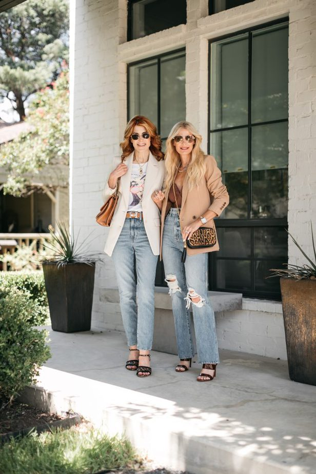 two women smiling and wearing boyfriend blazer and jeans