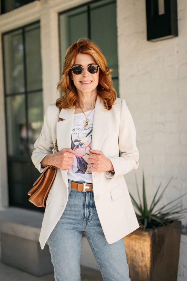 woman holding her blazer