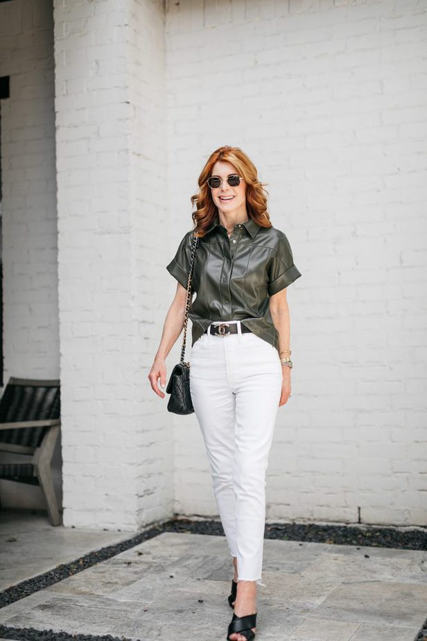 woman wearing olive green top and white pants