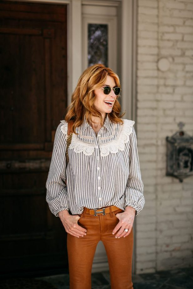 woman wearing orange pants and laced button down shirt