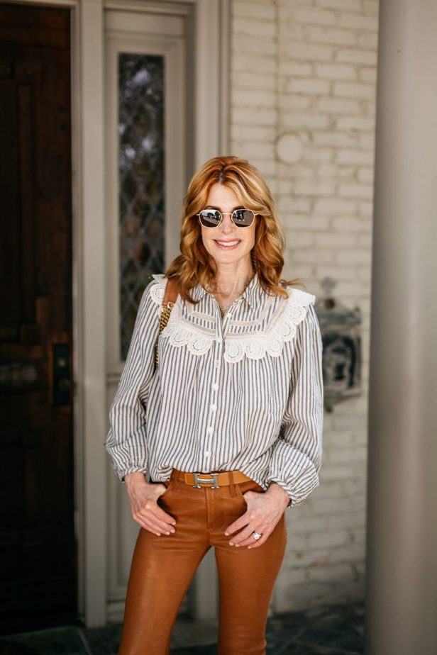 woman wearing laced button down shirt and orange pants for sweater weather