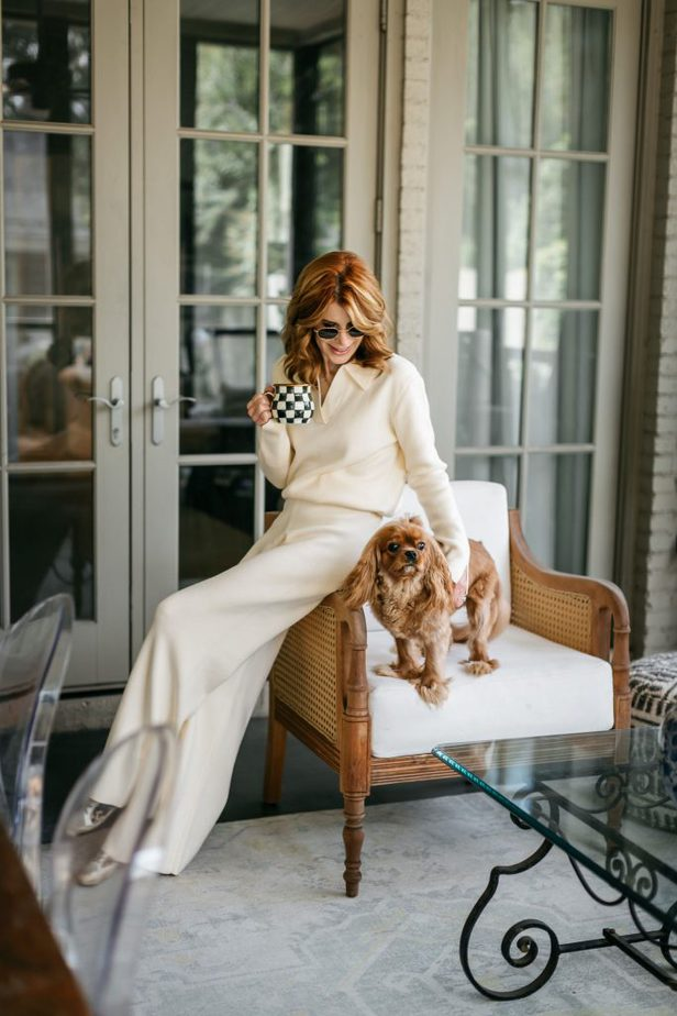 woman in her Matching Knit Sets sitting with her dog