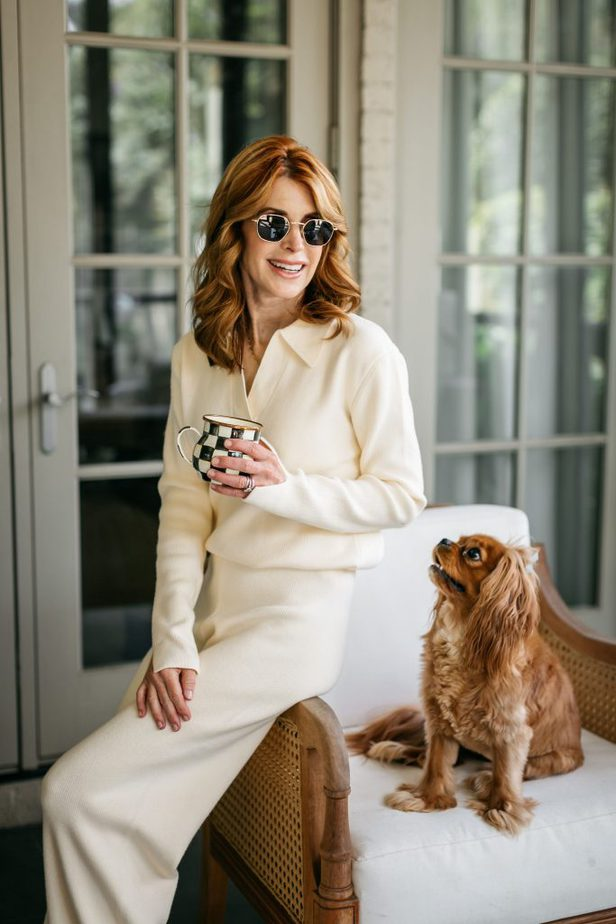 woman drinking coffee and sitting with her dog in her Matching Knit Sets