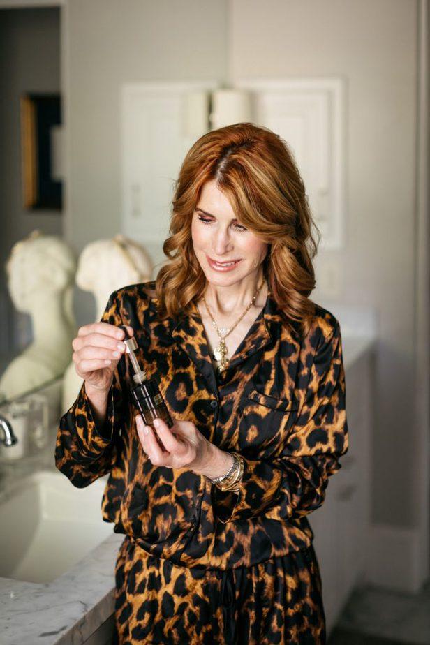 woman holding a facial serum
